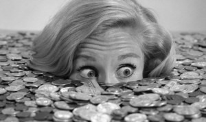 1960s Bug-Eyed Surprised Woman Buried In Coins Money Symbolic