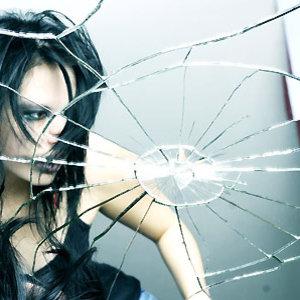 123-woman-reflected-in-broken-mirror300sq-medium_new